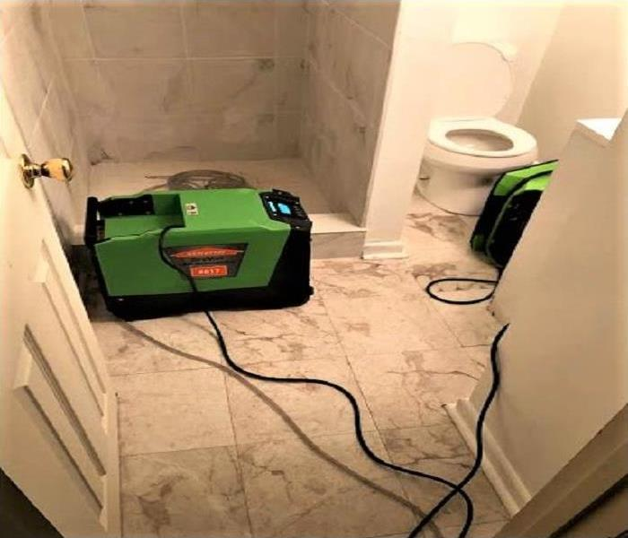 Sewage clean up in affected basement bathroom