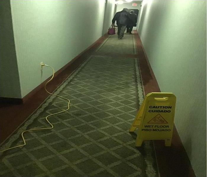 Hallway water damage from pipe burst