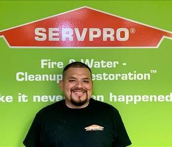 male employee with green SERVPRO background